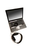 Laptop and headset isolated on the white Stock Images