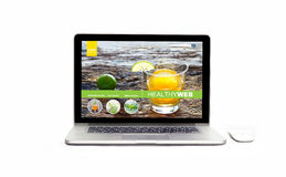 Laptop with healthy website on the screen on isolated white background, infusion diet and detox royalty free stock image
