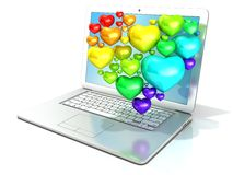 Laptop with heart shaped cluster of hearts Royalty Free Stock Photos