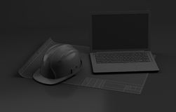 Laptop and helmet on dark background royalty free stock images