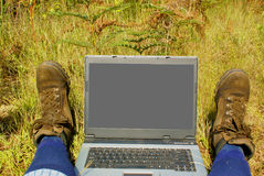 Laptop on hiking trail Stock Photo