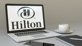 Laptop with Hilton Hotels Resorts logo on the screen. Modern workplace conceptual editorial 3D rendering Stock Photo