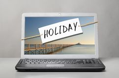 Laptop with holiday note Stock Photography