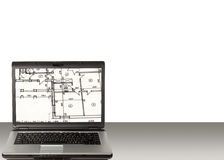 Laptop and home plan. Laptop with architecture home plan in screen placed on table Royalty Free Stock Image