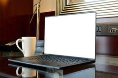 Laptop on hotel desk Stock Photo