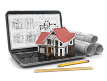 Laptop, house and blueprint with project. Royalty Free Stock Image