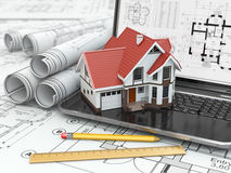 Laptop, house and blueprint with project. 3d Stock Images