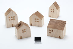 Laptop and houses. Stock Photos
