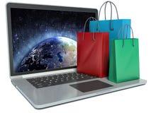 Laptop i kolorowi torba na zakupy Online interneta pojęcie Obrazy Stock