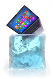 Laptop in ice cube Royalty Free Stock Images