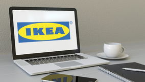 Laptop with Ikea logo on the screen. Modern workplace conceptual editorial 3D rendering. Laptop with Ikea logo on the screen. Modern workplace conceptual royalty free illustration