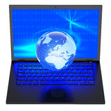 Laptop with illuminated globe Royalty Free Stock Photo