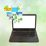 Laptop and images Stock Images