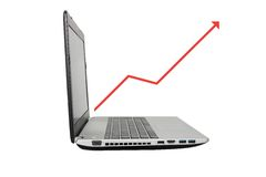 Laptop with an increasing  graph Royalty Free Stock Photo