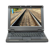 Laptop with infinity railroad on screen Royalty Free Stock Photos