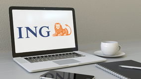Laptop with ING Group logo on the screen. Modern workplace conceptual editorial 3D rendering Stock Photos