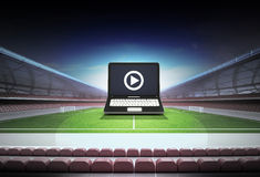 Laptop internet football watch in midfield of football stadium Stock Photography