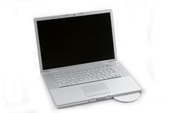 Laptop isolated with CD Royalty Free Stock Images