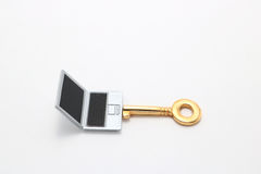 Laptop and key. Stock Images