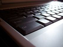 Laptop Keyboard. With a ray of light over the keys Stock Image