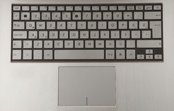 Laptop keyboard. And touch mouse Stock Photography