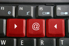 Laptop keyboard. With logo @ on keys Stock Photos