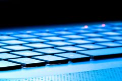 Laptop keyboard as a background toned to blue Royalty Free Stock Photos