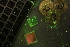 Laptop keyboard with bitcoins and prisms. Laptop keyboard with bitcoins and green laser stock images