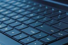 Laptop Keyboard (Blue Tone). Closeup shot of laptop keyboard under blue lighting royalty free stock photo