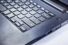 Laptop Keyboard  In Close Encounter With Camera. Close Up Shots Of Laptop On White Stock Image