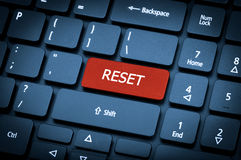 Laptop keyboard. The focus on the Reset key. Close-up laptop keyboard. The focus on the Reset key. Toning is blue Royalty Free Stock Photography