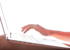 Laptop keyboard and hand Royalty Free Stock Images