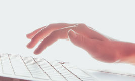 Laptop keyboard and hand Stock Photography