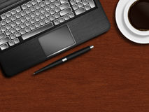 Laptop keyboard, pen and cup of coffee on wooden desk Royalty Free Stock Photo