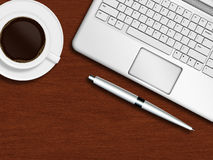 Laptop keyboard, pen and cup of coffee on wooden desk Stock Image