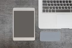 Laptop keyboard, smart phone and tablet. Workplace. Top view.  Royalty Free Stock Images