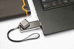 Laptop keyboard and usb flash Stock Image