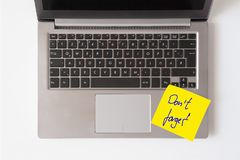 Laptop with note Don`t forget. Laptop keyboard with yellow note Don`t forget Stock Image