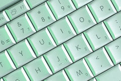 Laptop keys in green light stock photos