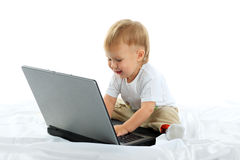 Laptop and kid Stock Photos