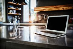 Laptop on kitchen counter. At home royalty free stock photo