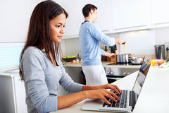 Laptop kitchen couple Stock Image