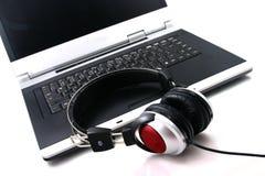 Laptop, Kopfhörer Stockbild