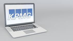Laptop with KPMG logo. Computer technology conceptual editorial 3D rendering. Laptop with KPMG logo. Computer technology conceptual editorial 3D Royalty Free Stock Photo