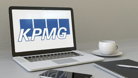 Laptop with KPMG logo on the screen. Modern workplace conceptual editorial 3D rendering. Laptop with KPMG logo on the screen. Modern workplace conceptual Royalty Free Stock Photo