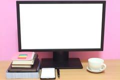 Laptop książki i umieszczamy na biurku i co zdjęcie stock