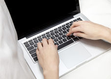 Laptop and ladies hands Stock Images