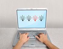 Laptop with lamps Royalty Free Stock Photos