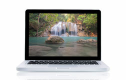 Laptop with landscape Erawan Waterfall Stock Photos