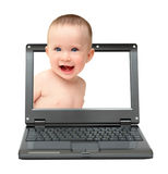 Laptop with laughing baby Stock Image